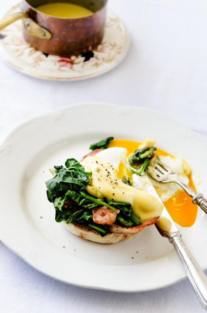 Eggs benedict florentine with hollandaise sauce, spinach and bac